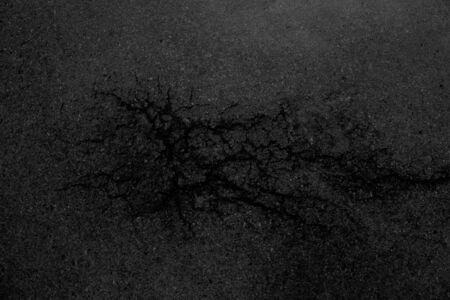 Background cracks of the asphalt.