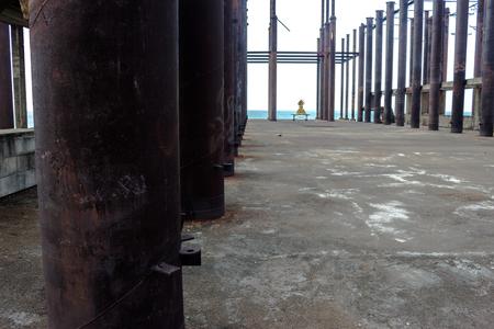 unfinished building: steel columns A building,old Unfinished building