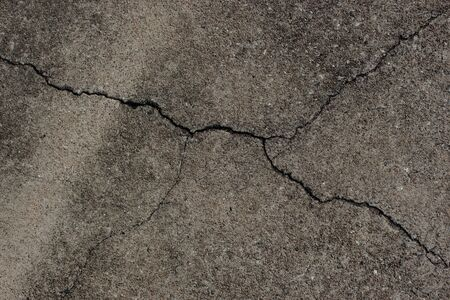 road surface: Cracks on concrete road surface. Stock Photo