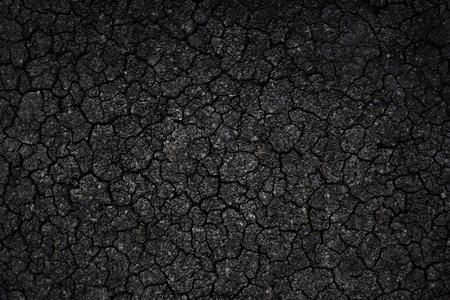 black textured background: Crack black asphalt road textured background.