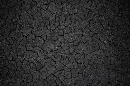 black textured background: Crack black asphalt textured background.