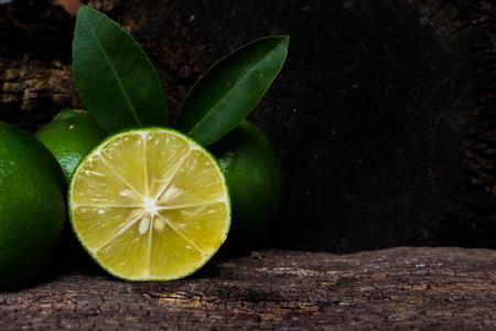 wood cut: Cut in half lemon wood background. Stock Photo