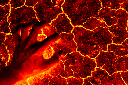 volcanic eruption: Global warming, ground volcanic eruption, Hand standing on the ground lava.
