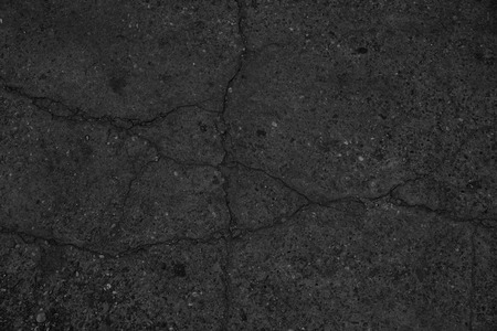 Crack black asphalt road surface background.