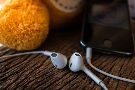 earphone: Earphone on wood background.