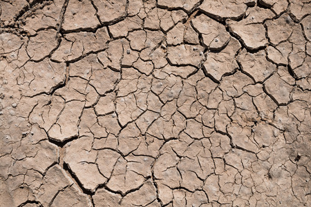 Crack dry ground drought texture background.