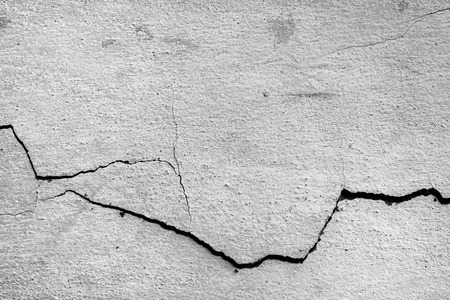 Crack old wall close up background.