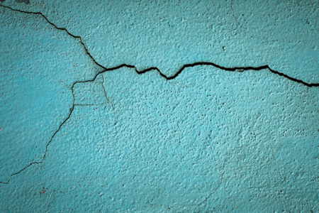 Crack old blue wall close up background.