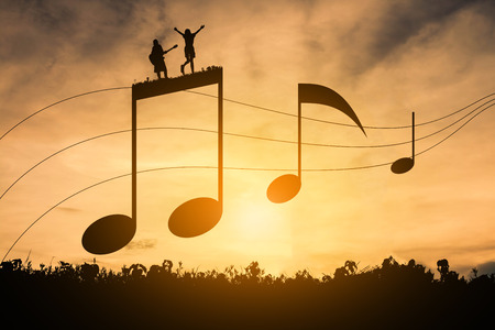 musical score: Silhouette music notation, Happy note, concept music. Stock Photo