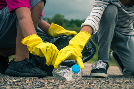 thai ethnicity: Group of kids volunteer help garbage collection charity environment. Stock Photo