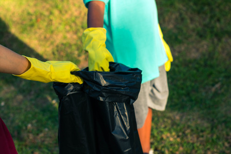 selfless: Group of kids volunteer help garbage collection charity environment. Stock Photo