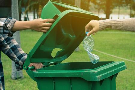 Group of kids volunteer help garbage collection charity environment. Foto de archivo