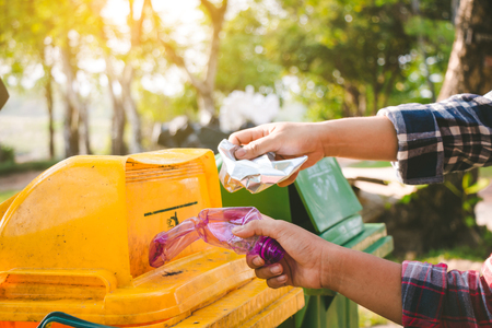 Child volunteer help garbage collection charity environment. Stock Photo