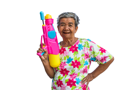 Grandmother playing water in Songkran festival isolated on white background.