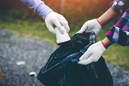 Group women volunteer help garbage collection charity environment.