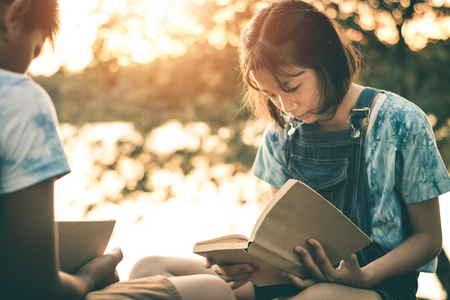 Men and women read books in quiet nature, concept read a books.