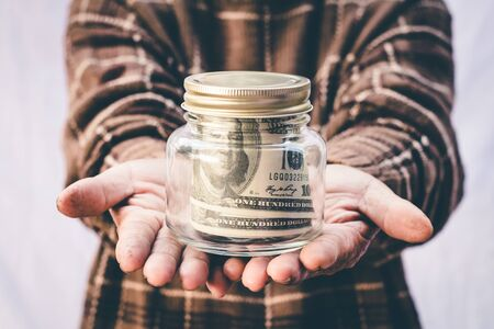 Grandmother's hand saving money, Concept save money for the future.