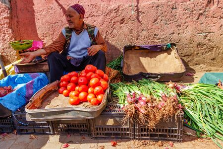 Marrakesh, Morocco - March 04 2019 Vegetable trader offer his fruits in the souk of Marrakesh. Editöryel