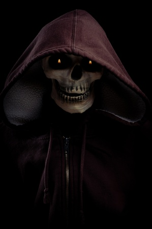 A Skeleton Wearing hoodie with flaming eyes.  Good dark image for Halloween