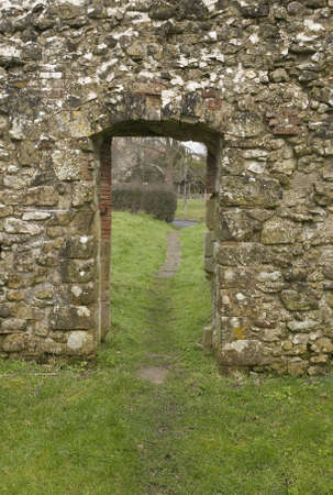 Doorway in an old stone wall of a derelict church photo