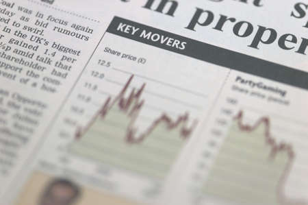 Section of a financial newspaper titled Key Movers photo