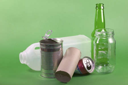 enviroment: Collection of items for recycling on a green background, concept of protecting the enviroment.