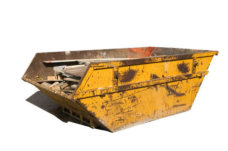 skip: Old yellow builders skip, Isolated on white, Clipping paths for skip and shadow.  Stock Photo