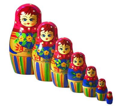 decreasing in size: Sette di legno tradizionali bambole russe, isolati su bianco