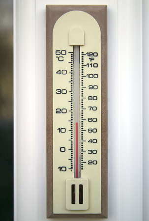 weather gauge: An outdoor thermometer on a window frame