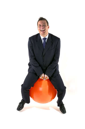 bounce: Businessman having fun on a space hopper Stock Photo