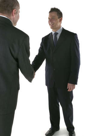Two businessmen meeting and shaking hands Stock Photo - 853636