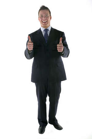 Businessman smiling and giving a 'thumbs up' gesture Stock Photo - 857510