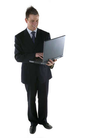entering information: Businessman entering some information on a laptop computer
