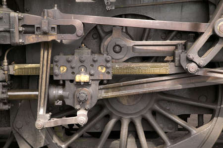 Close cropped image of a locomotive wheel and pistons photo