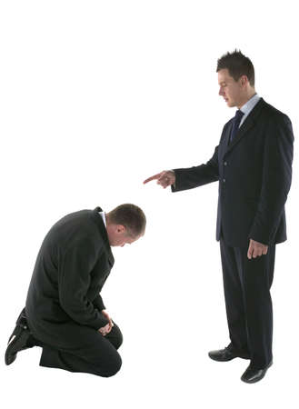 reprimand: Boss pointing the figure of blame onto a cowering employee, isolated on white. Stock Photo