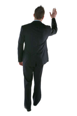 Man in a suit waving goodbye, isolated on white photo