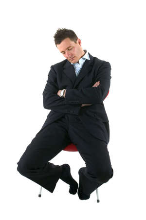 Businessman asleep on a chair, isolated on white. Stock Photo