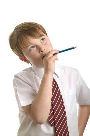 scholastic: School boy in deep thought, isolated on white.