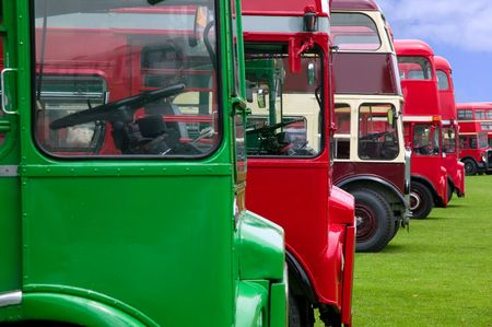 Vintage double decker buses in a row. photo