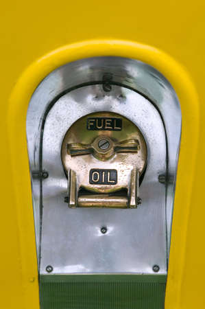 Fuel and Oil filler cap on a vintage vehicle. photo