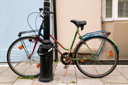 lampost: Colourful old bicycle chained to a lampost. Stock Photo