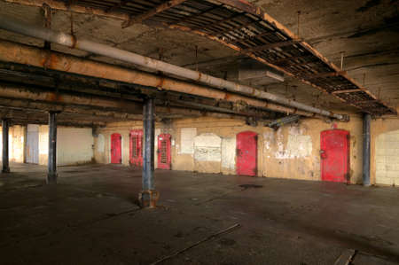 damp: Shot of the damp and dark basement area under an old pier. Stock Photo