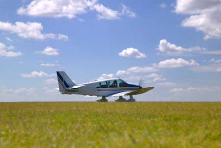 Light aircraft on a grass runway about to take off. photo