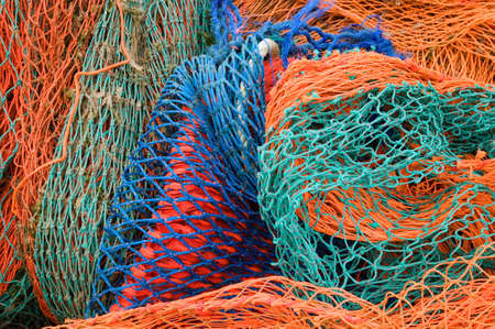 Close up of multi coloured industrial fishing nets. photo