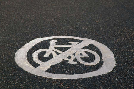 prohibitive: No Cycling sign painted in reflective road paint.