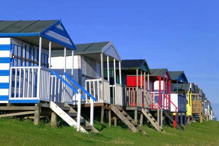 Colourful beach huts against a blue sky. Stock Photo - 1511419