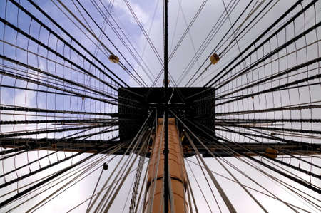 View up the mast into the rigging of an old tall ship. photo