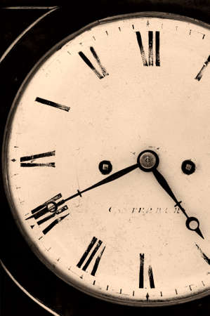 Close cropped image of an antique clock, dark and grainy sepia toned image. Stock Photo - 1621693