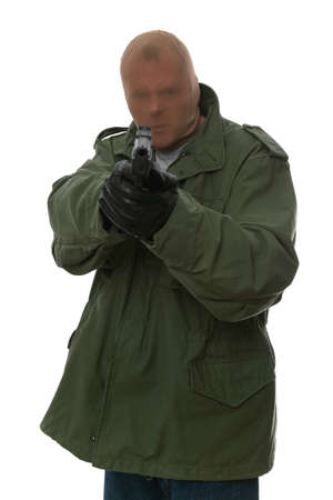 Armed robber pointing a handgun towards his victim. Stock Photo - 1621683