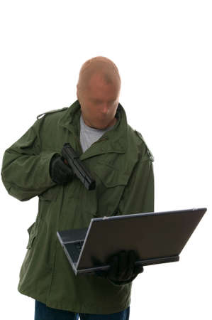 web scam: Bank robber aiming a handgun at a laptop. Concept of Internet bank robbery, Identity fraud, Corporate theft etc. Isolated on white.